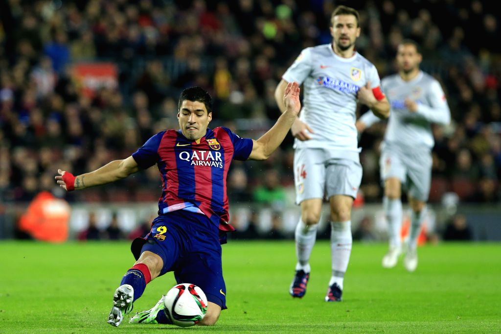 Barcelona's Uruguayan forward Luis Suarez competes during the King's Cup quarter-final first leg soccer match against Atletico Madrid at the Nou Camp