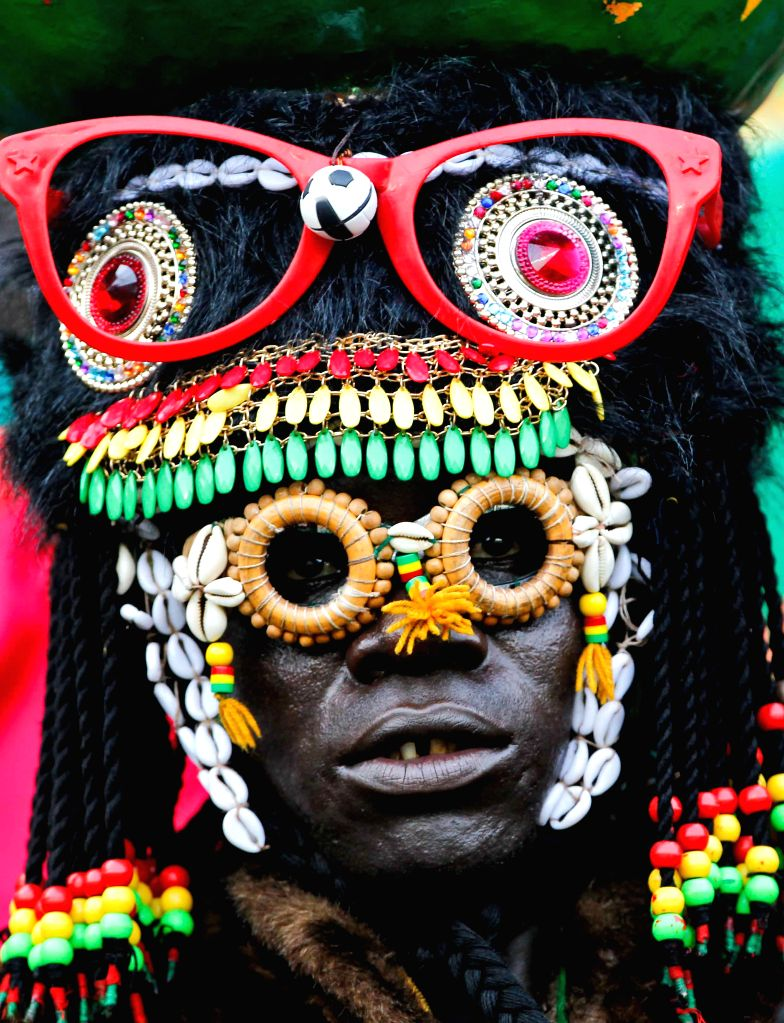 A fan of Burkina Faso is seen before the group match of African Cup of Nations between Equatorial Guinea and Burkina Faso in Bata, Equatorial Guinea, Jan. .