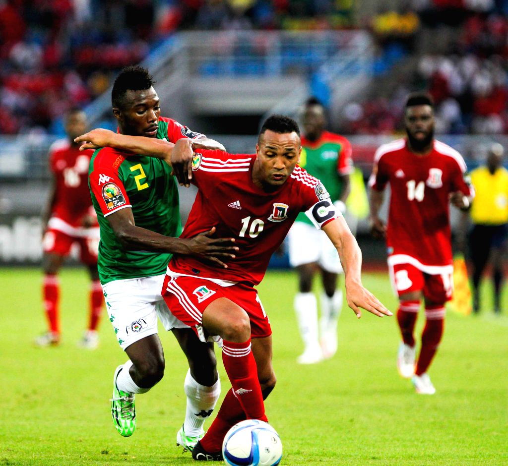 Emilio Nsue Lopez of Equatorial Guinea (Front) vies with Steeve Farid Yago during their group match of African Cup of Nations between Equatorial Guinea and