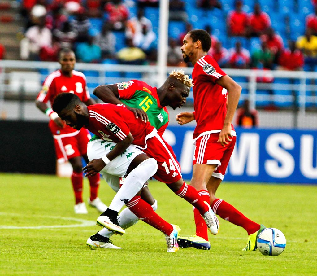 Enrique Boula Senobua (L) of Equatorial Guinea vies with Aristide Bance of Burkina Faso during their group match of African Cup of Nations in Bata, ...