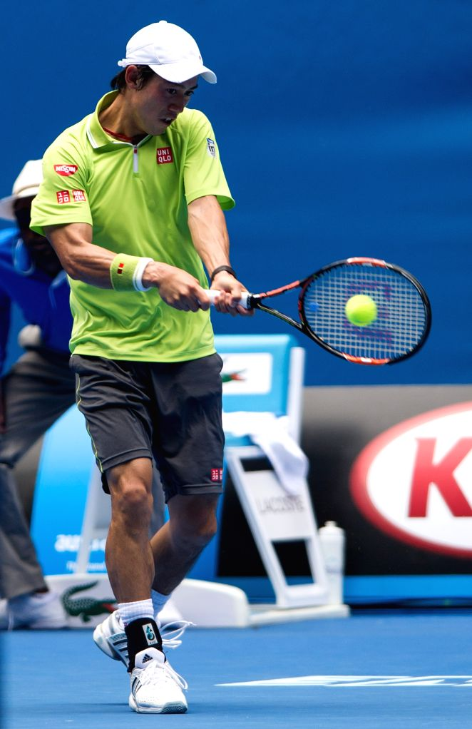 Kei Nishikori of Japan returns the ball during his men's singles second round match against Ivan Dodig of Croatia at the Australian Open tournament in