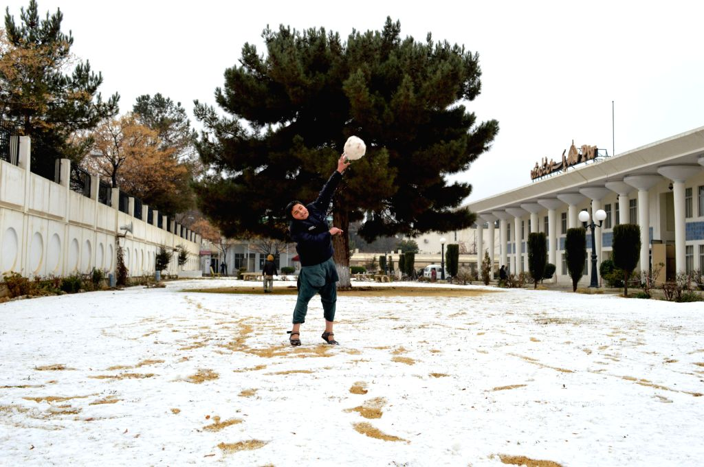A boy throws a snowball towards his friends after the snowfall in southwest Pakistan's Quetta, Jan. 21, 2015. The valley of Quetta received its first ...