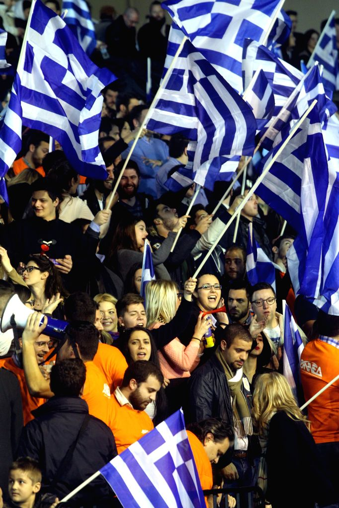 Supporters of New Democracy wave Greek flags during Prime Minister Antonis Samaras' pre-election speech at the Taekwondo Indoor Stadium in southern ... - Antonis Samaras