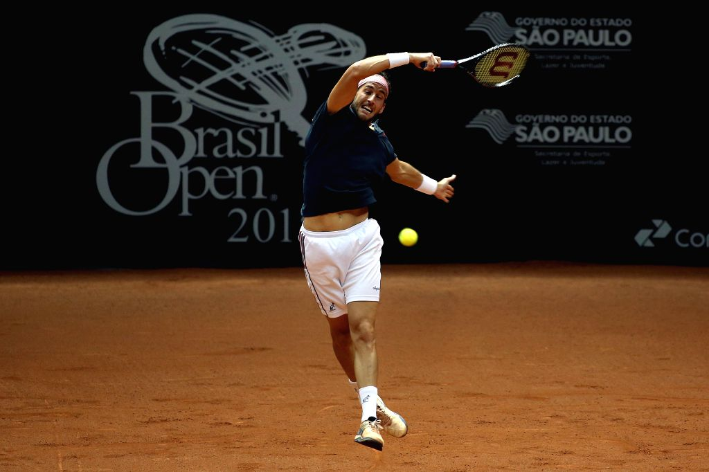 Italy's Luca Vanni returns the ball to Pablo Cuevas of Uruguay during the final match of the Brazil Open of ATP, in Sao Paulo, Brazil, on Feb. 15, ...