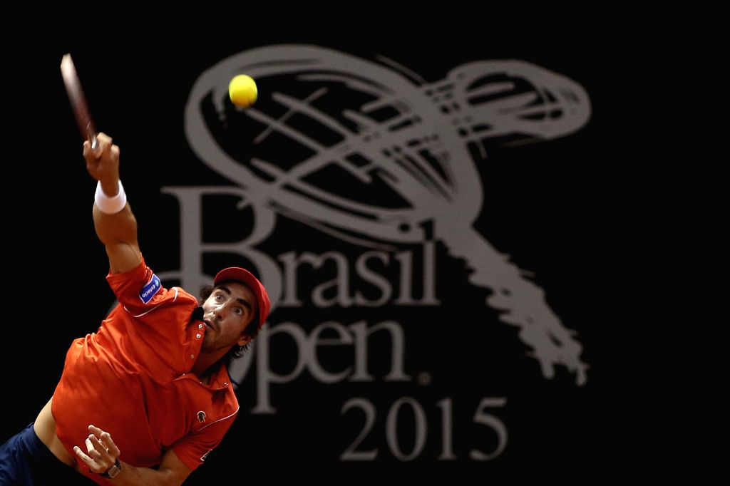 Uruguay's Pablo Cuevas serves the ball to Luca Vanni of Italy during the final match of the Brazil Open of ATP, in Sao Paulo, Brazil, on Feb. 15, ...