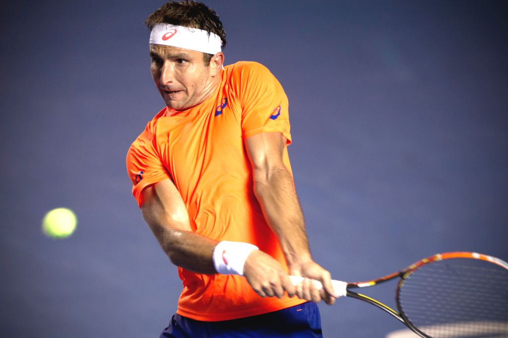 Australia's Marinko Matosevic returns the ball during the men's single match against Spain's David Ferrer at the Abierto Mexicano Telcel tennis ...