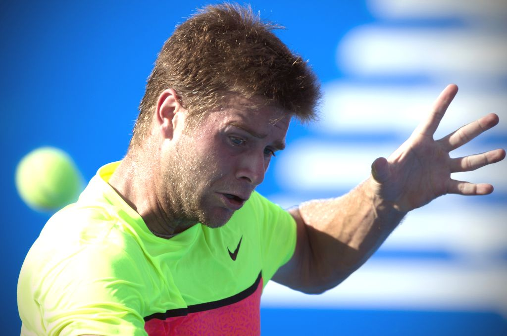 Ryan Harrison of the United States returns the ball during the men's single match against Bulgaria's Grigor Dimitrov at the Abierto Mexicano Telcel ...