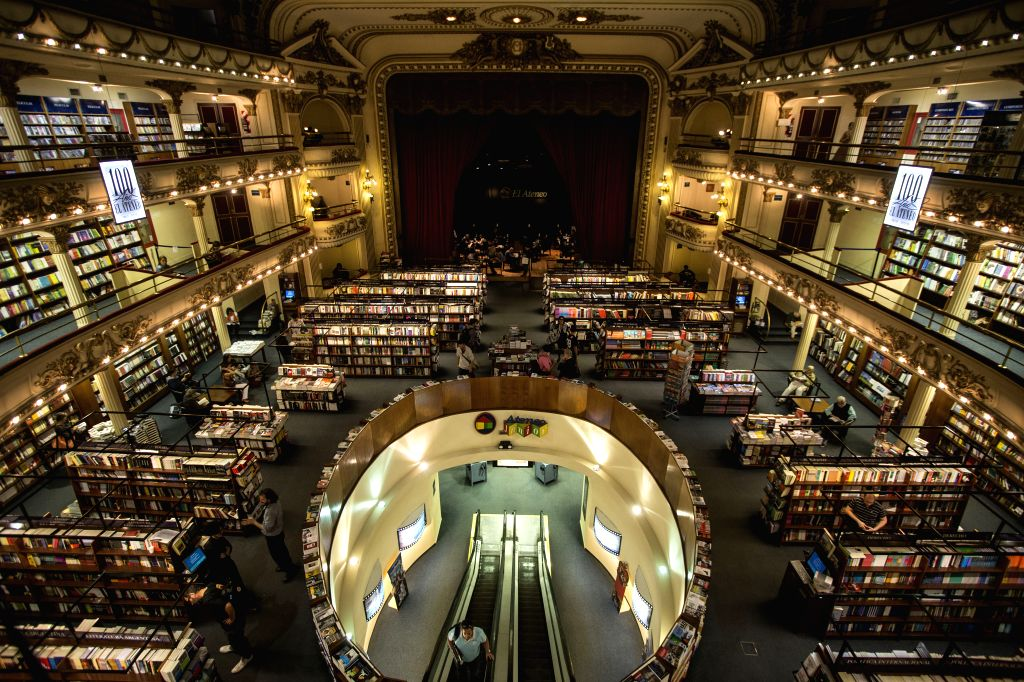 """People enjoy their time at the El Ateneo Bookstore in Buenos Aires, capital of Argentina, March 26, 2015. """"The Guardian"""", a British ..."""