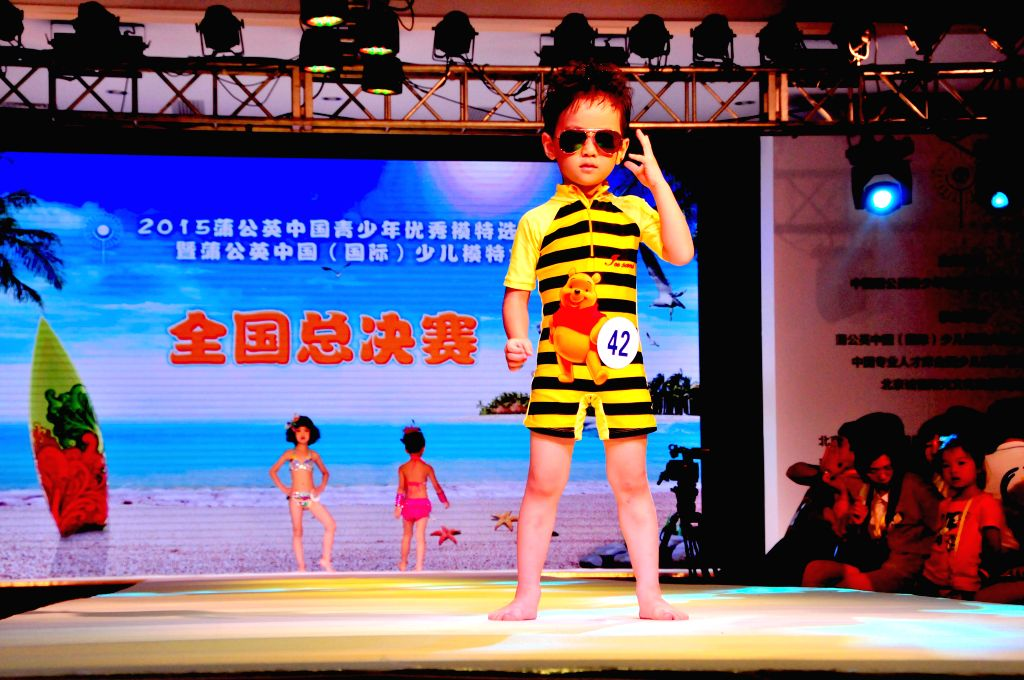 A boy shows on a children's model contest in Beijing, capital of China, Aug. 17, 2015.  More than 170 children took part in the final of a children's ...