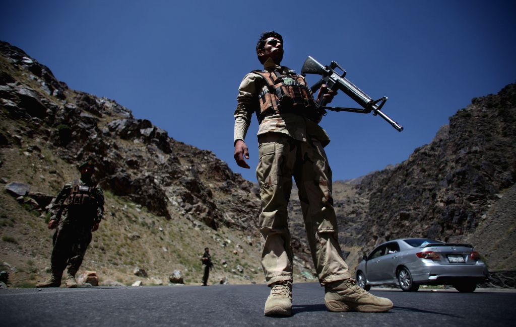 Afghan national army soldiers stand guard at an army checkpoint on the outskirt of Kabul, Afghanistan, Aug. 17, 2015. Unknown armed men abducted a foreign ...