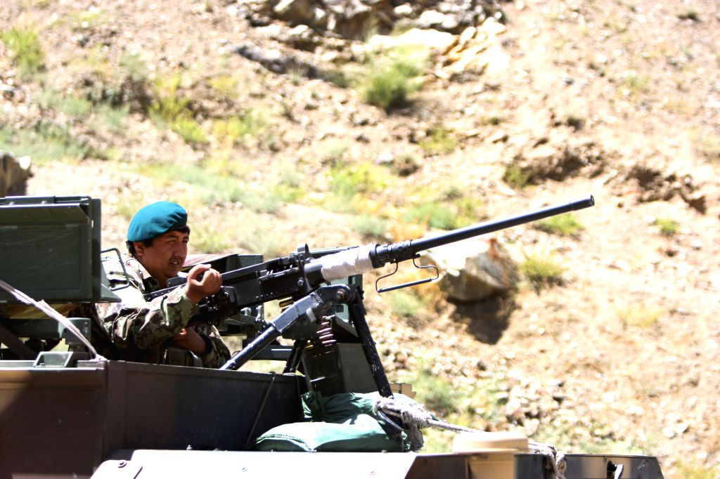 An Afghan national army soldier keeps watching on a military vehicle at an army checkpoint on the outskirts of Kabul, Afghanistan, Aug. 17, 2015. Unknown ...