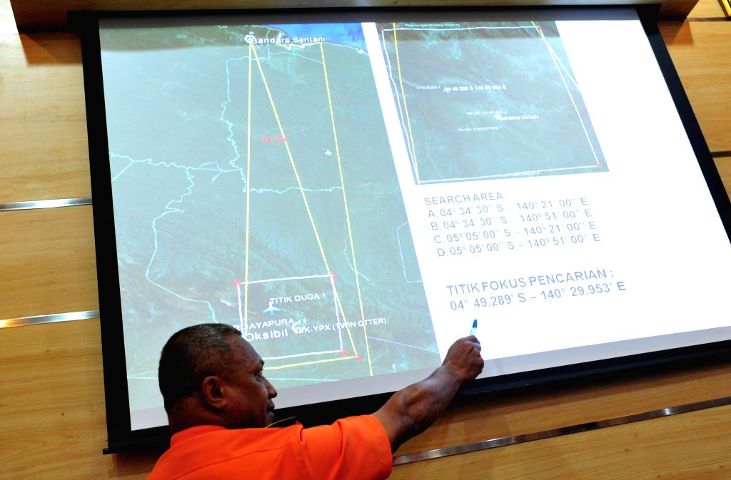 Deputy operational search and rescue of the National Search and Rescue Agency (Basarnas) Heronimus Guru shows the location of a crashed plane from a big ...
