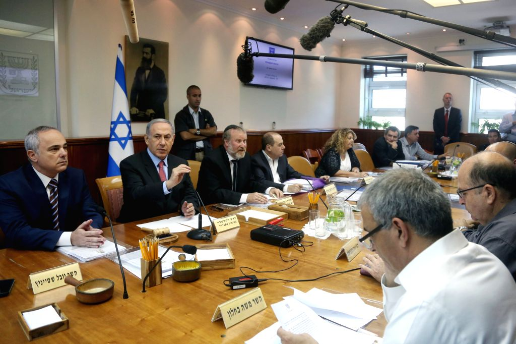 Israeli Prime Minister Benjamin Netanyahu (2nd L) leads the weekly cabinet meeting at the Prime Minister's Office in Jerusalem, on Aug. 16, 2015. ... - Benjamin Netanyahu