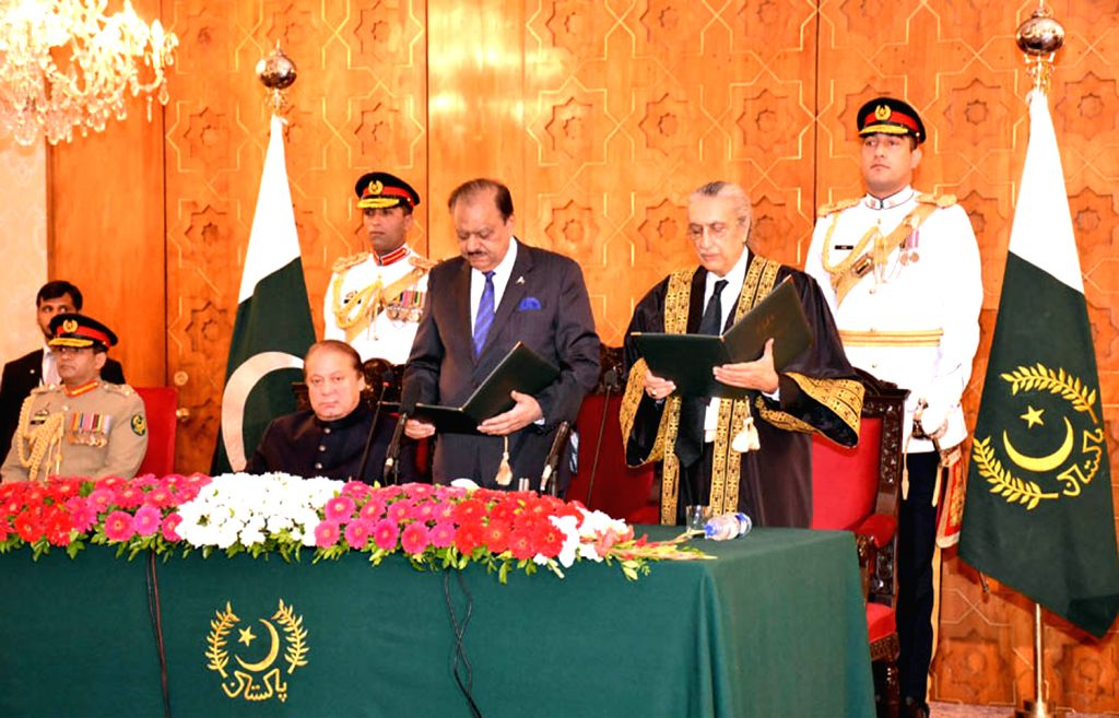 Photo released by Pakistan's Press Information Department (PID) on Aug. 17, 2015, shows Pakistani President Mamnoon Hussain (3rd R) administering the ...