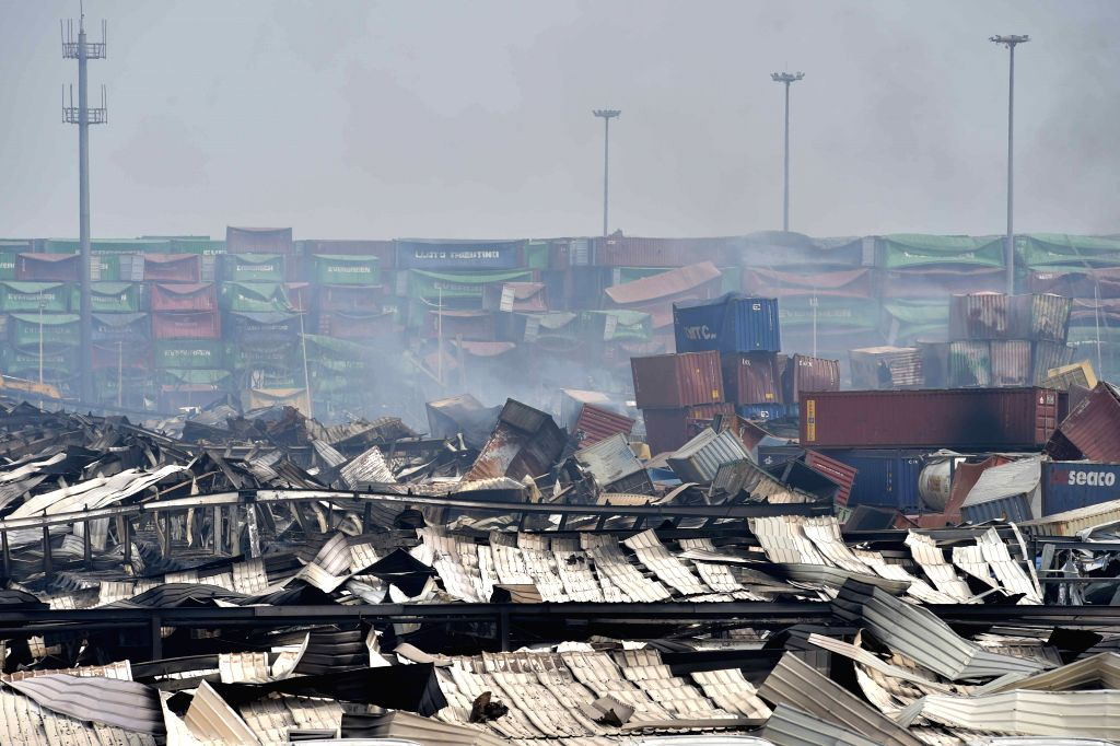 Photo taken on Aug. 17, 2015 shows the warehouse explosion site in Tianjin. Death toll of the massive Tianjin blasts rose to 114 after rescuers found ...