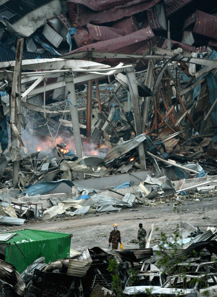 Photo taken on Aug. 17, 2015 shows the burning debris at the explosion site in Tianjin, north China. Thousands of rescuers, soldiers and medics have ...