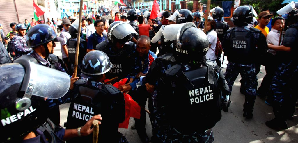 Protesters clash with Nepal police during the second day of a general strike called by alliance of 30 opposition parties led by UCPN-Maoist in ...