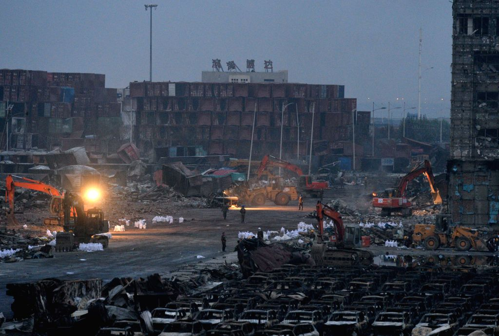 Rescuers clear away obstacles at the explosion site in Tianjin, north China, Aug. 17, 2015. Thousands of rescuers, soldiers and medics have been ...