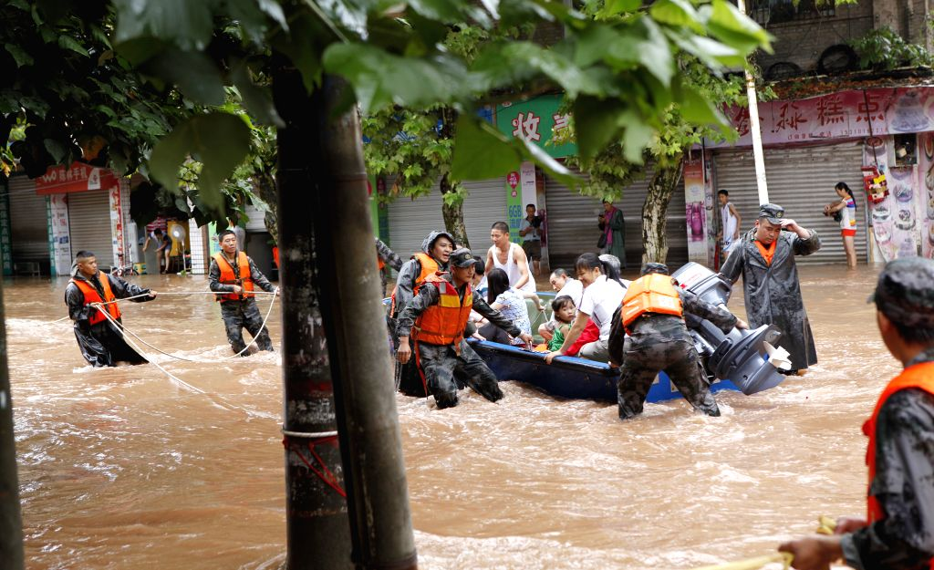 Rescuers evacuate residents in Banqiao Township of Yongchuan District, southwest China's Chongqing Municipality, Aug. 17, 2015. A heavy rain hit most ...