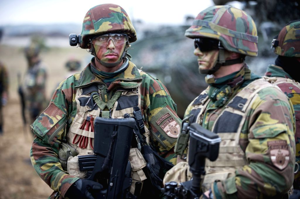 RUKLA (LITHUANIA), Oct. 22, 2015 Soldiers stand guard during a military exercise called Baltic Piranha in Rukla, Lithuania, Oct. 22, 2015. Over 300 soldiers from Belgium and ...