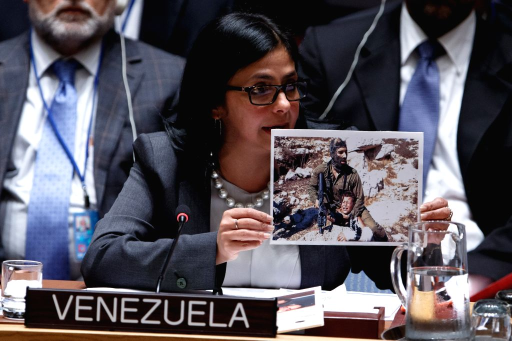 Venezuelan Foreign Minister Delcy Rodriguez displays a picture of an Israeli soldier detaining a Palestinian boy during a United Nations Security ... - Delcy Rodriguez