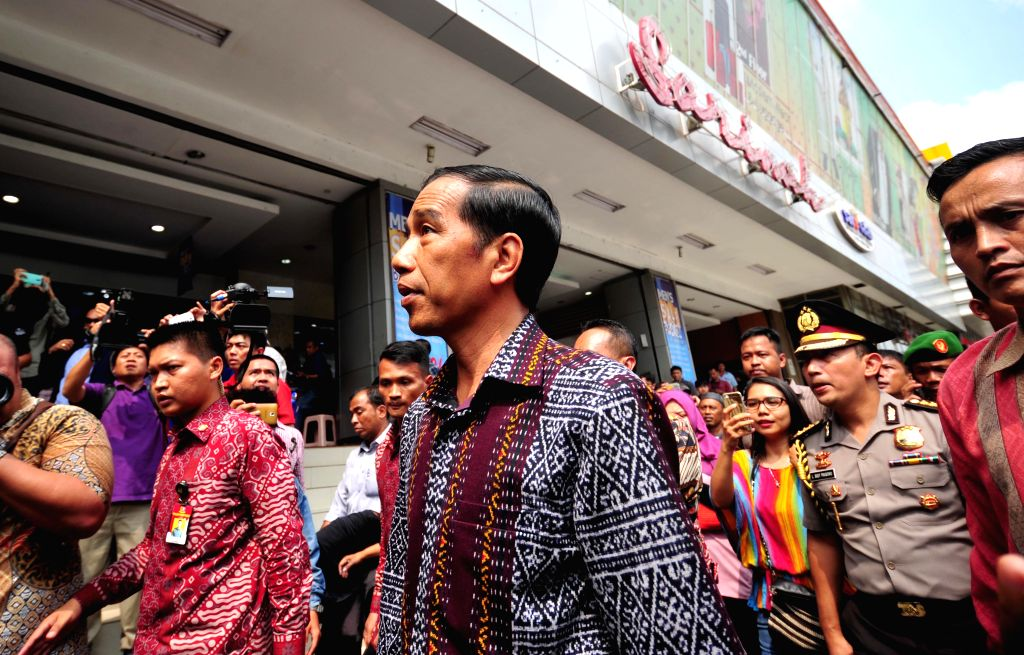 Indonesian President Joko Widodo (C, front) visits a shopping mall near the bombings and gun attacks site in Jakarta, Indonesia, Jan. 15, 2016. ...
