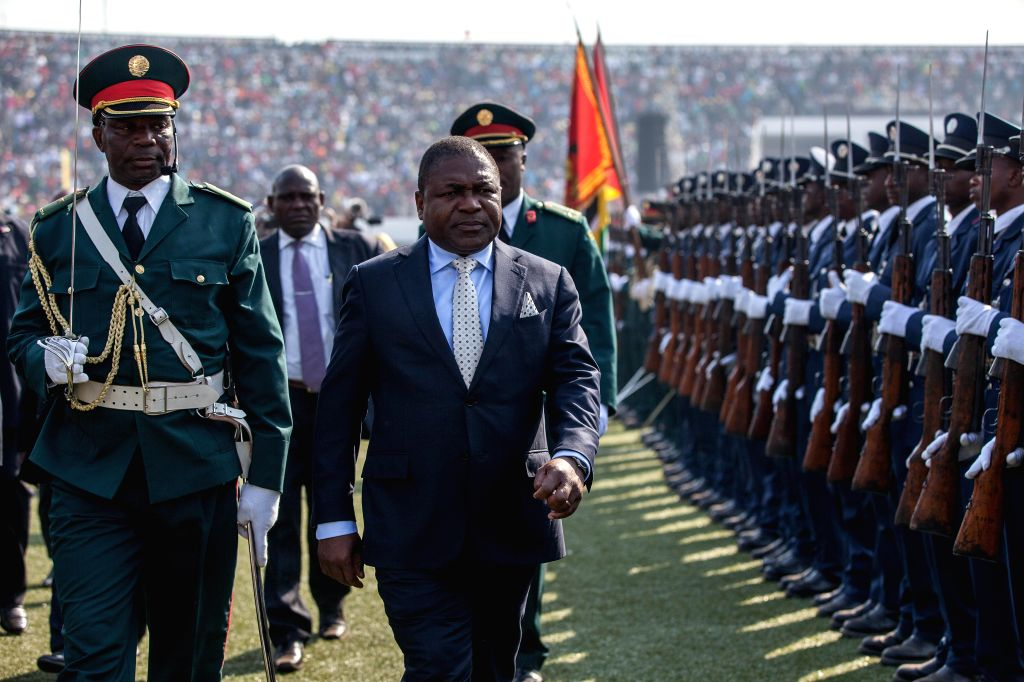 Mozambican President Filipe Nyusi (2nd L) reviews the guard of honor during the celebration for the 40th anniversary of the country's independence in ...