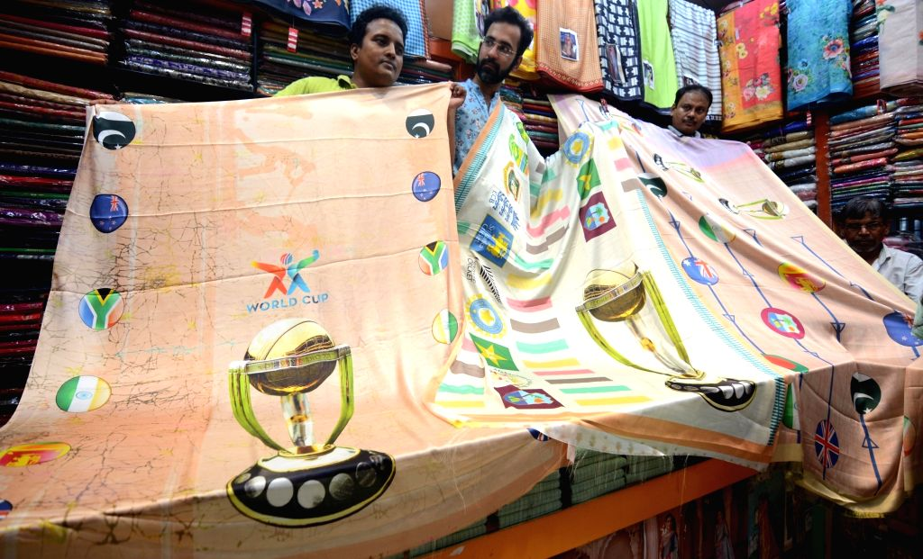 2019 ICC Cricket World Cup-themed saree carrying the images of the World Cup Trophy, logos of Cricket Boards and flags of participating countries being sold at a shop in Kolkata, on June 8, ...