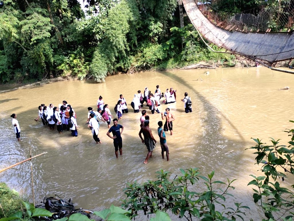 24 school students hurt when a hanging bridge collapsed in Assam -