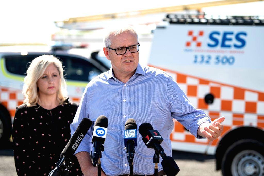 27 March 2021, Australia, Sydney: Australian Prime Minister Scott Morrison (R) speaks to media during a visit to State Emergency Service at Claremont Meadows. Photo: James Gourley/AAP/dpa/IANS - Scott Morrison