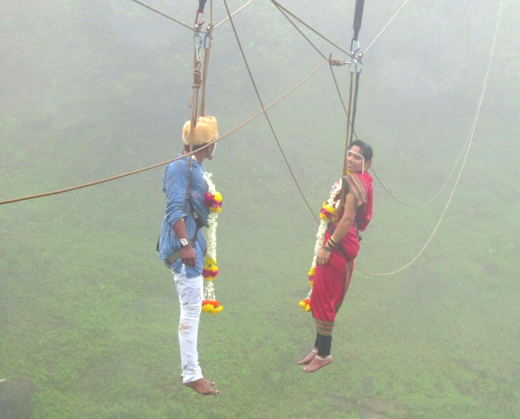 30-year old Jaideep Jadhav, a mountaineer and pharma marketer, and his fiancee Reshma Patil tie knots hanging above mid-air over above Western Ghats in Kolhapur of Maharashtra on Aug 1, ... - Reshma Patil