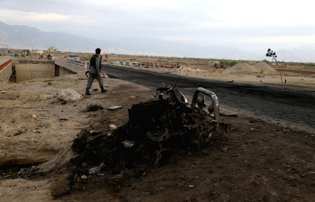 6 Afghan military base workers killed in attack