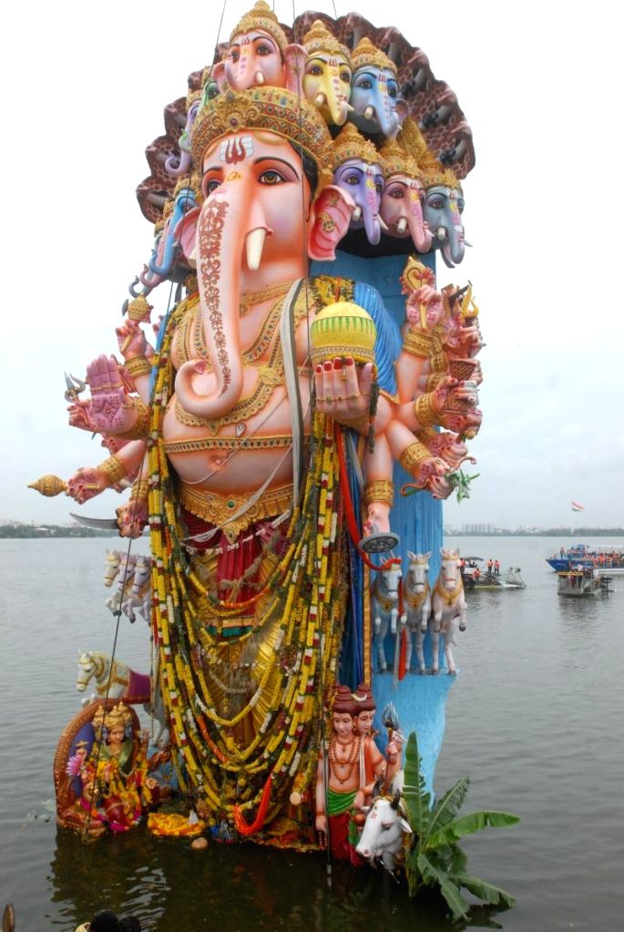 61-feet high idol of lord Ganesh immersion underway at Hussain Sagar lake in Hyderabad on Sep 12, 2019.