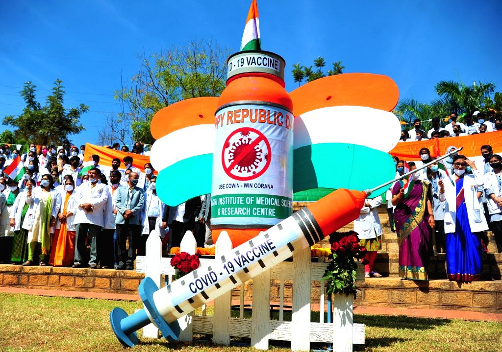 7 feet tricolor COVID-19 vaccine bottle and Injunction made by Sapthagiri Hospital Medical students and doctors to create awareness on COVID-19 vaccine at Sapthagiri Hospital on the ...