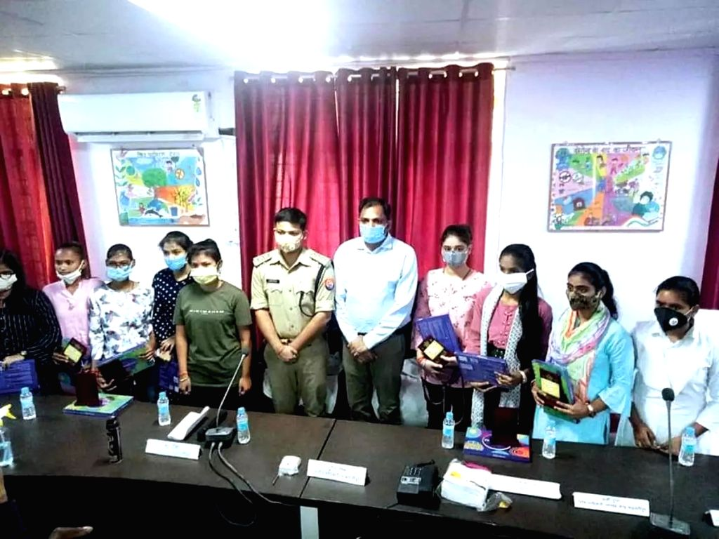 9 girls take charge as Officers for a Day.