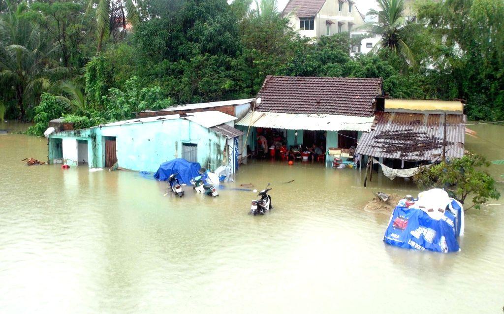 90 dead, 34 missing in Vietnam floods, landslides