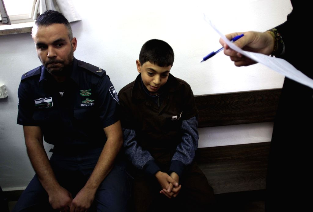 A 14-year-old Palestinian is seen at the District Court in Jerusalem, on Nov. 19, 2015. The Jerusalem Magistrate's Court charged the 14-year-old Palestinian on ...