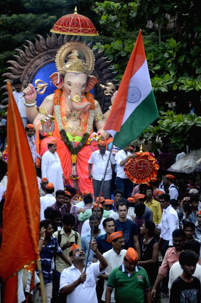 A 16ft. Ganesha idol on way from workshop in Mumbai on August 15, 2013. (Photo::: Sandeep Mahankal/IANS)