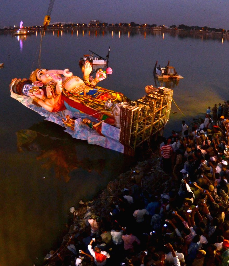 A 60-feet-tall Ganesh idol being immersed in Hussain Sagar of Hyderabad on Sept 9, 2014.