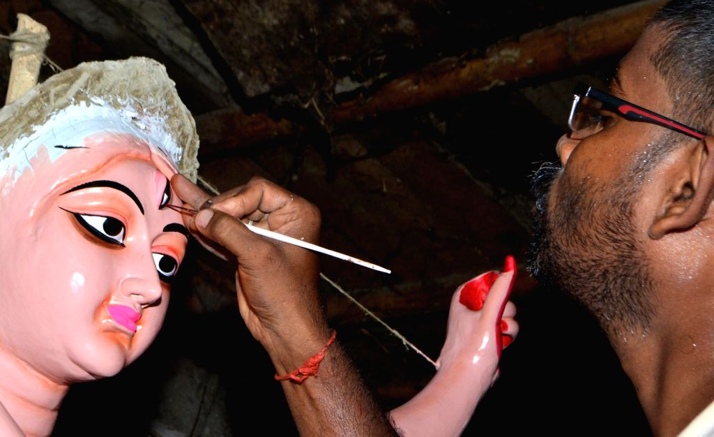 A artist busy making Durga idol at a Guwahati workshop ahead of Durga Puja on Oct 1, 2016.