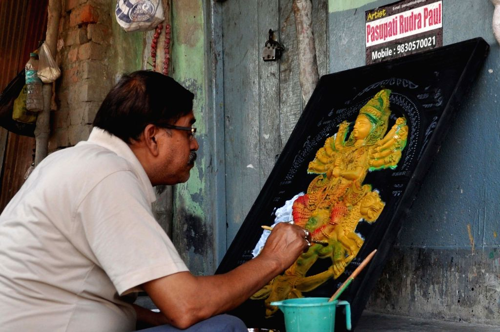 A artist gives finishing touches to an idol at Kumartully workshop during the 21-day nationwide lockdown imposed to contain the coronavirus, in Kolkata on March 31, 2020.