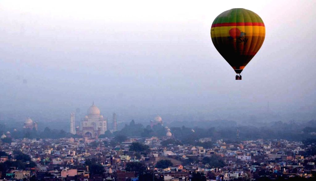 A balloon floats in the skies of Agra during hot air balloon festival in Agra, on Nov 27, 2016.