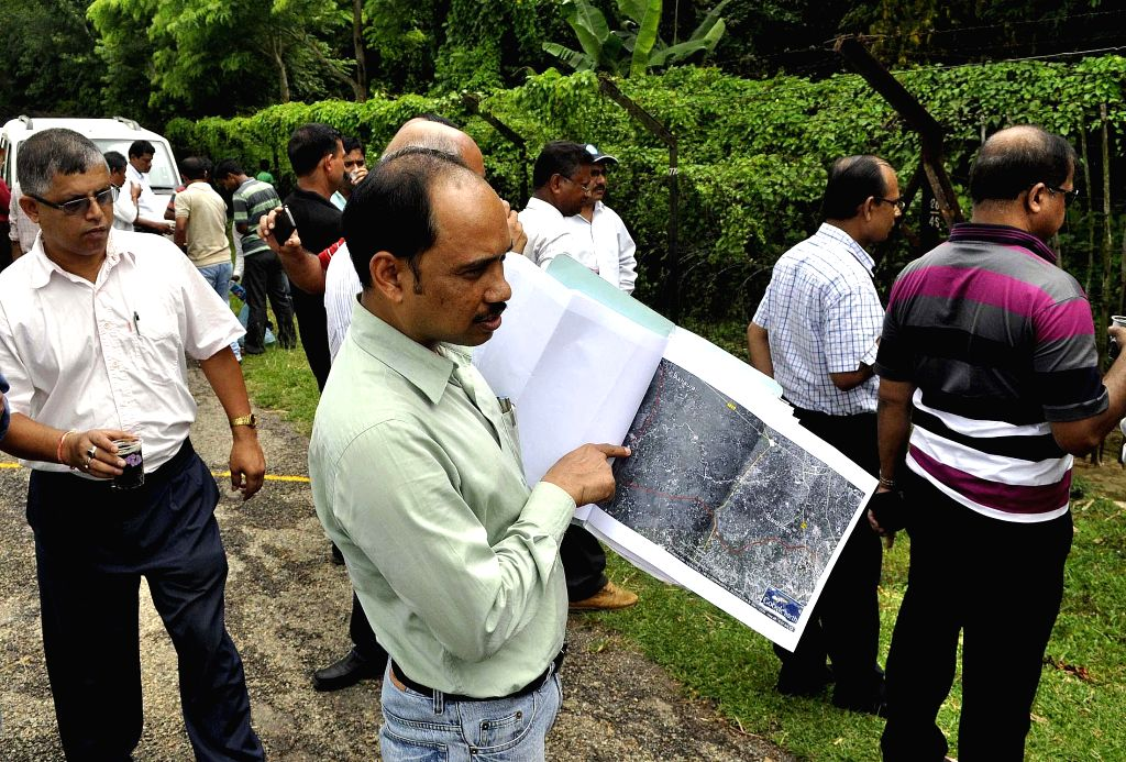 A Bangladeshi railway team conducts ground verification of proposed Indo-Bangladesh rail link at Nischintapur border village some 13 km south of Agartala on June 18, 2014. The work on the rail link ..