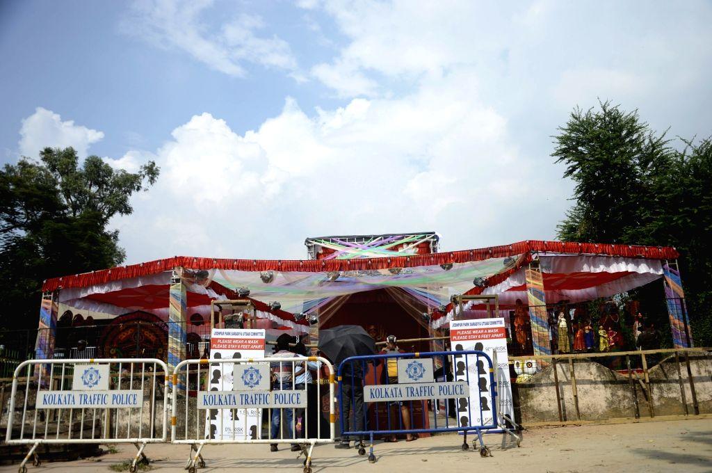 A barricaded community puja pandal ahead of Durga Puja celebrations, at Jodhpur Park in Kolkata on Oct 21, 2020.