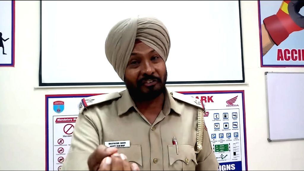 A baton wielding police personnel in Chandigarh has wielded a pen to write lyrics advising motorists that they can't escape for a song after committing traffic violations. Assistant Sub Inspector Bhupinder Singh, posted in the traffic wing of Chandig