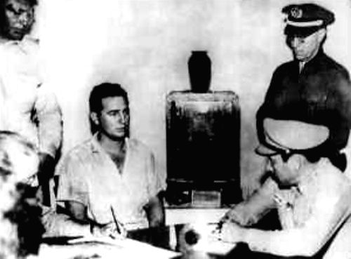 A beardless Fidel Castro (centre) under arrest after his first abortive revolt