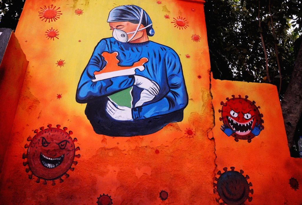 A beautiful wall painting on COVID-19 comes up for public awareness at the District magistrate office (SDM) Lajpat Nagar, in New Delhi on Nov 24, 2020.
