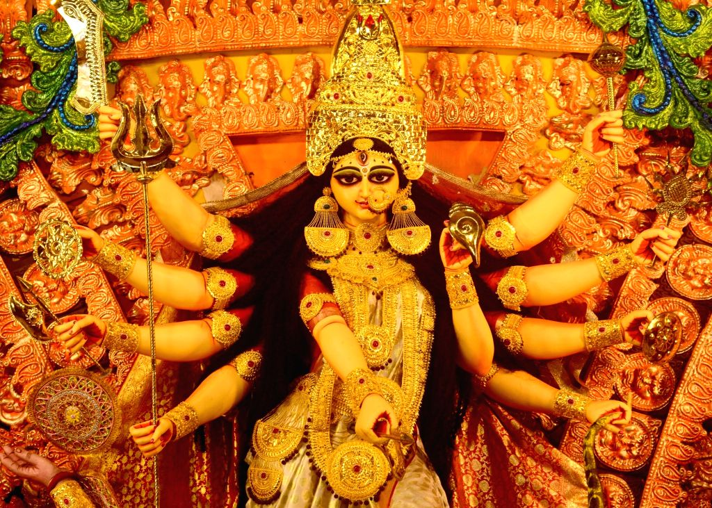 A beautifully decorated idol of Goddess Durga at a community puja pandal on the theme of the Kedarnath Temple comes up ahead of Durga Puja celebrations, at Sree Bhumi Sporting Club in ...