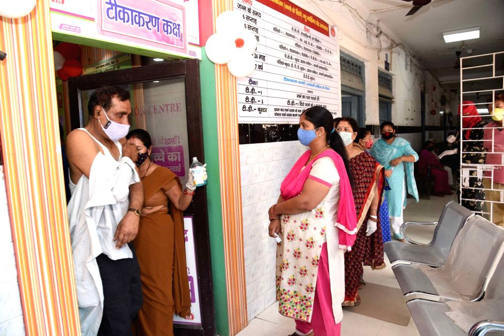 A beneficiary receiving the second dose of COVID-19 vaccine, amid rising coronavirus cases across the country, at a government dispensary, in Patna, Saturday, April 17, 2021.
