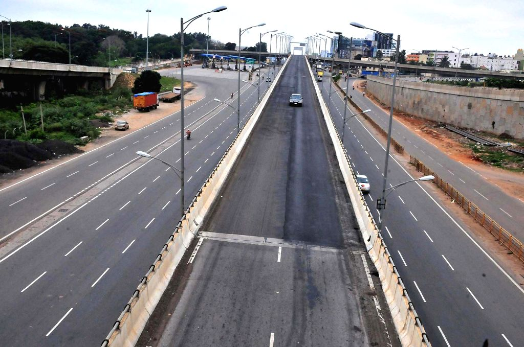 A Bengaluru road bears a deserted look during a complete lockdown that has been reimposed on Sundays from July 5 to August 2 across Karnataka to confine citizens at home and restrict their ...